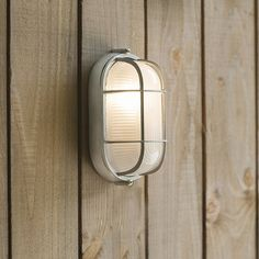 Chatham small bulk head light is a stylish, industrial style, outdoor wall mounted light with a nautical feel. Sandblasted finish for a unique appearance. Outdoor Wall Mounted Lighting, Outdoor Lighting, Exterior Lighting, Outdoor Walls, Modern Lighting, Glass Shades, Industrial Style, Modern Contemporary, Gray