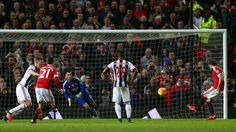 Juan Mata of Manchester United scores his team's second goal from the penalty spot