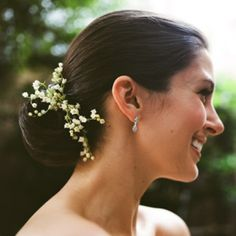 Sleek updo with lilly of the valley