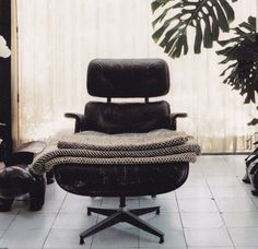 "When I was at the Eames House several years back, I asked about the worn leather on the lounge chair in the living room.  The explanation given to me was that they used glove leather on the very first chairs produced. I guess they were going for that ""mitt"" look. The material proved to be too soft so a sturdier leather was used."