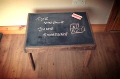 Childrens chalkboard table made from reclaimed pallet wood also ideal coffee table via Etsy - remove the legs and use as a cheese serving try for parties to id the types