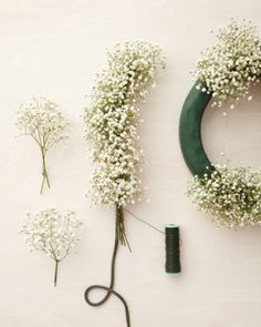 DIY Baby's Breath Wedding Garland...consider using for garland on ground on sides of main aisle and continue to decorate arbor with sprays of twigs interspersed