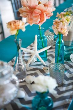 Love the blue colored bases, maybe w a yellow chevron table runner and white flowers in vase?   Beach wedding with @Wendy Felts Felts Felts Wilson Photography, @Dana Curtis Curtis Curtis Goodman, @Sherrie Bowe-Hernandez Bowe-Hernandez Bowe-Hernandez Mullis, @Rachel Rowell, and @Elizabeth Lockhart Lockhart Lockhart Baldwin Smith