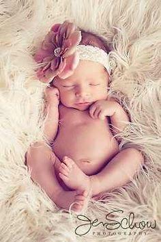 Newborn picture - girl version.  (Definitely make a headband like that!)
