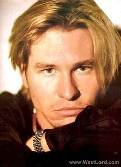 Man: Val Kilmer  Pose: portrait, chin on arm, arms folded, petulant