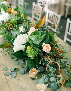 This greenery infused table runner is the centerpiece your wedding tables are begging for!