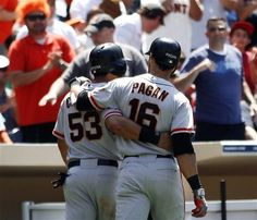 Melky Cabrera (53) and Angel Pagan (16) walk together back to the dugout after Pagan's two-run home run against the San Diego Padres in the seventh inning of a baseball game, Thursday, June 7, 2012, in San Diego.