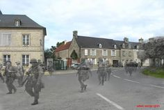 Members of the 101st Airborne, Screaming Eagles, passing through Sainte-Marie-du-Mont, on their way to contact the enemy. June 12, 1944.