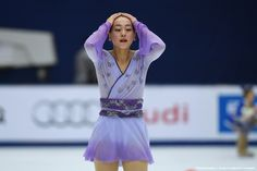 Mao Asada of Japan reacts after performing during the women's free Skating event of the Cup of China ISU Grand Prix of Figure Skating in Beijing on November 7, 2015. AFP PHOTO / WANG ZHAO (1534×1023)