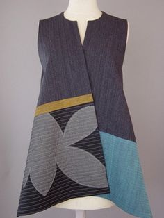 Long Round Neck Vest with Abstract Shapes and Teal Accent