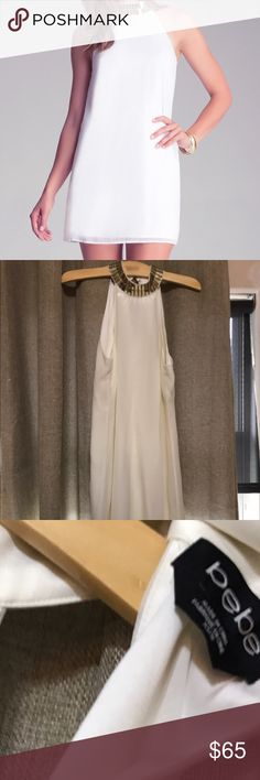 Bebe White Embellished shift bebe dress, size XS. Details: White, flowy, shift dress, with a gold, embellished neck line. Worn only once, excellent condition. bebe Dresses Mini