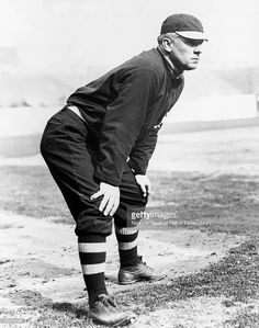 John McGraw waits to field the ball . John McGraw was a manager of the Baltimore Orioles in c.1899, then the New York Giants from c.1902 - c.1932 . ~ (Getty Images)
