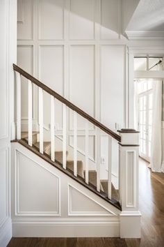Newel post and square spindles. Lovely paneling.