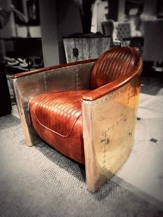 This chair really caught my eye. Aircraft sheet metal with distressed leather. Looks a bit #DieselPunk found a Restoration Hardware.