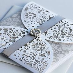 Gorgeous Laser Cut Wedding invitation made by Designs By JoJo.  Competition winner at Imagine DIY.  #DIYwedding