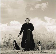 Drawn towards this photo... Johnny Cash with his dogs. Interestingly enough the dogs names are Hell & Redemption.
