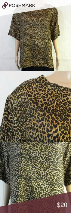 "Silk Short Sleeve Vintage Top by Stunt Attention: Vintage clothing lovers and collectors of 1980's clothing.   Note: This size 2X, box style blouse looks awkward on my much smaller size mannequin.   100% Silk. Tiny leopard print in Black and hues of Brown and Gold.   Short sleeve.  Pullover.  ""Boxy"" style.  Two button opening in the back at the neck with self fabric loop closure.  When laid flat measurement from underarm to underarm is 27"", and the length from shoulder seam to bottom edge is…"