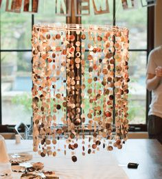 lovin' the idea for a DIY mobile with hand-sewn paper confetti...you could change the look in a big way with paper palette choice