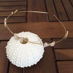 pave crystal bow headband pave crystal bow headband in clear & gold. one size. thin wire headband with 6 beautiful pave crystal bow embellishments and capped ends for wearing comfort. simple, chic, and oh so sweet! Accessories Hair Accessories
