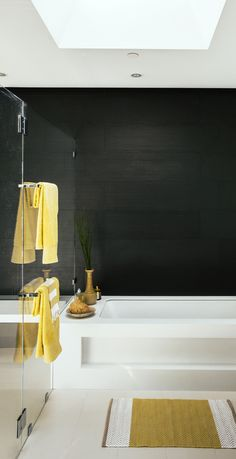 The glass shower enclosure, large-format tile in black, and chrome fixtures give the master bath modern sensibility.