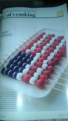 Cute 4th of July dessert; thread raspberries, marshmallows, blueberries on wooden skewers, plate and serve with white chocolate fondue.