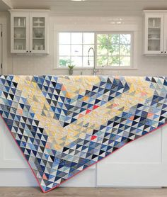Don't we all know a quilter who treasures a great triangle quilt? #quilt #quilting #scrapquilt