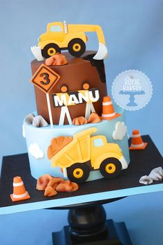 A construction cake for Manu's 3rd birthday. I LOVED making this and borrowed the 2D decor style from Corrie's Cakes. Thank you!