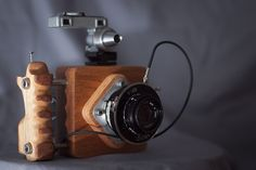 6x6 diy camera: Wood block body with parts from all sorts of medium format cameras!