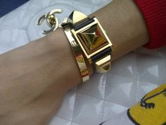 YG Love bracelet + Hermes Medor watch.