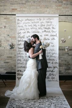 Turn your story into a unique ceremony decor idea. Or write a chapter from your favorite book, meaningful quotes, poetry, or lyrics and repurpose it during the reception as a photobooth backdrop.