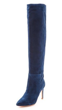 i bought knee-high navy suede boots last year for fall and haven't regretted it since. these are so good!