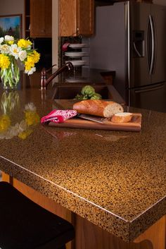 April is National Recycling Month - Using recycled glass countertops in your kitchen remodel is one way to be more earth friendly in the home.