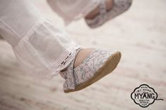 Mary Jane shoe - Pink and Blue Floral. Non-slip, suede soles and trendy fabric uppers with easy fasten Velcro, the perfect first shoe. Our fabrics and trims are carefully selected, to create a shoe that is unique and truly special.