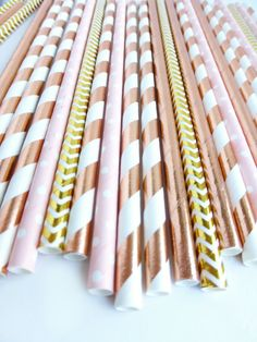Rose Gold Metallic Paper Straws  Beautiful metallic rose gold colors!  - Choose your quanitity  - These superior quality paper straws are the perfect elegant touch to any party event, whether a wedding, engagement party, bridal or baby shower, graduation party, or just for fun! - Includes mix of: striped, chevron, polka dot and solid pattern - Colors Include: Shades of rose gold foil, gold foil and blushy pink  - These straws are sturdy and will hold up in your drinks, milkshakes, cocktails…