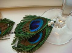 Peacock feather wine charms.