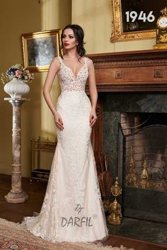 Sleeveless and backless mermaid wedding gown with lace straps. This dress is ideal for a bride who is not afraid to show off her figure as it features a daring neckline and tattoo lace on an open back. The Bride, Wedding Bride, Wedding Gowns, Lace Tattoo, Fit And Flare Wedding Dress, Flowy Skirt, Princess Style, Mermaid Wedding, Floral Lace