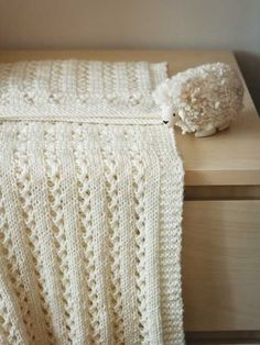 Knitting pattern for Sweet Pea Blanket with lace ribs