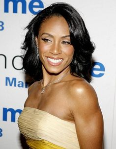 The lovely Jada Pinkett-Smith. Long layered hairstyle.