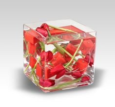 I do love tulips, and these center pieces look scifi, great, and should not be too expensive to make!