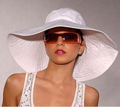 WIDE-BRIMMED SUMMER HAT You will need: Kraft paper glue or scotch tape tape measure compass approx. 1 yd. of Pellon ® fleece interfacing, 45″ wide approx. 1 1/2 yds. of bottom-weight or uphol…