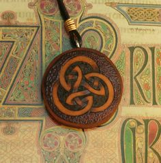 Celtic Knot Woodburned and embossed gourd necklace. $15.00, via Etsy. http://www.etsy.com/listing/125011092/celtic-knot-woodburned-and-embossed?
