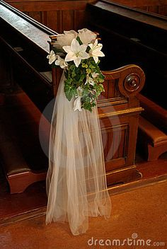 wedding church pew bows | Wedding pew bow with white organza and white lilys on a wood church ...