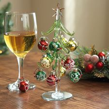 """Art Glass Tree with Wine-Charm Ornaments. Charming art-glass tree comes with its own glass-ball ornaments - and they double as wineglasscharms! Dainty8"""" H tree includes 12 ornaments.. Price: $14.99"""