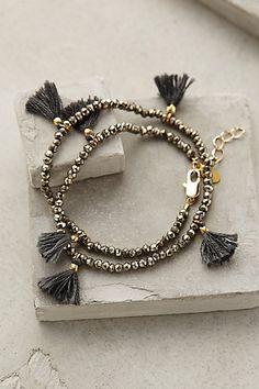 """Fluttered Tassel Wrap Bracelet - anthropologie.com -  pyrite, metal, cotton, 13"""" long, .75"""" tassels"""