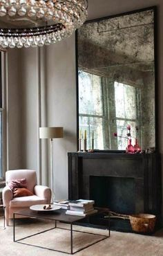 Antique mirror over a fireplace makes for a very romantic vintage design.