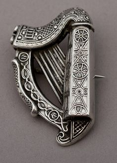 Antique Irish silver brooch in the form of the Irish harp. The harp is decorated with traditional Celtic motifs, in the traditional manner. The hallmarks are clear, except Hibernia who is only partially visible.