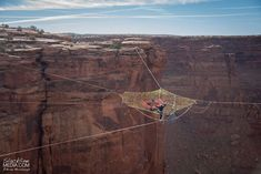 The Moab Monkeys, a Utah-based group of athletes, have no issues with vertigo or adrenaline. They recently set up a spider web net over a canyon near Moab, Utah at a head-spinning height of 400 ft to relax and BASE jump. The hand-woven, pentagonal web is 200ft. away from the nearest cliff.
