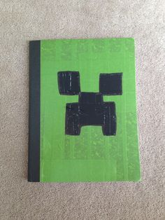 Homemade minecraft school supplies...composition notebook covered in Frog tape, detailed with black duct tape & Sharpie marker. Great kid project.