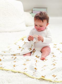 Dream Muslin Blanket in Giraffes - This extra soft and cuddly blanket can grow with your little one all the way through toddler years. Perfect as a play mat and later as a crib blanket, we love how functional (and adorable!) it is!