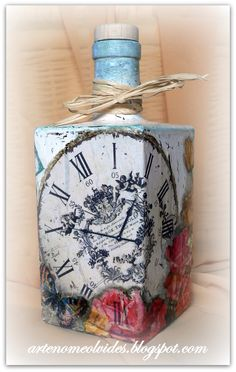 I'd add silk flowers to the bottom where the colored areas are Glass Bottle Crafts, Wine Bottle Art, Diy Bottle, Bottle Vase, Altered Bottles, Vintage Bottles, Bottles And Jars, Glass Bottles, Jar Art